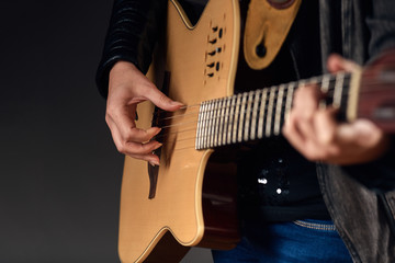 Close-up of woman with guitar