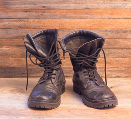 old leather black military ankle boots closeup