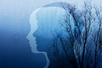 Sadness in Life Concept, Present by Silhouette Shape of Man and Woman combinated with Old Dry Tree and Rain, Blue Filter Effect