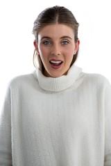 Portrait of surprised woman wearing sweater