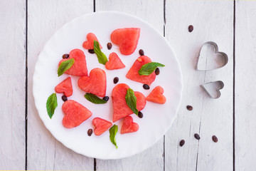 Watermelon cut in heart shape pieces with mint