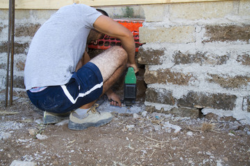 bricklayer building a new wall in a site