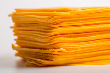 Cheddar cheese slices close up