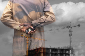 Double exposure man survey and civil engineer stand on ground working in a land building site.