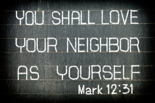 """""""YOU SHALL LOVE YOUR NEIGHBOR AS YOURSELF"""" Bible Verse Chalk Writing on Old Chalkboard Background."""