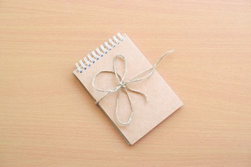 Notepad on wood board background.using wallpaper or for education, business photo.Take note of the product for book with paper and concept or copy space and advertising.