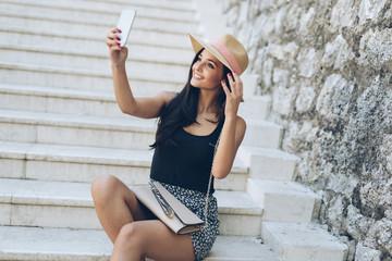 Attractive girl taking selfie
