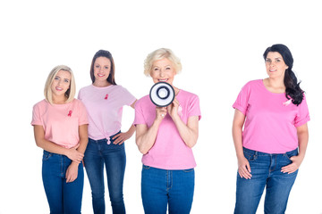 women in pink t-shirts with megaphone
