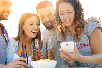 Group of friends having fun taking selfie pictures