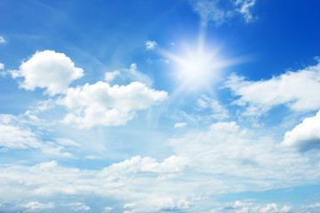 sun and clouds in the blue sky background