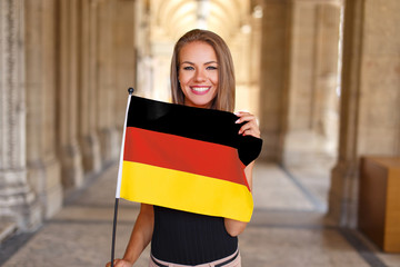Young woman smile with flag of Germany
