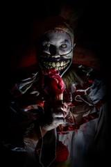 horror clown eating heart ice cream