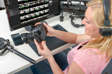 blond young woman photographer working with computer and graphic tablet