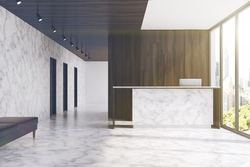 Marble reception in a dark wood office, toned
