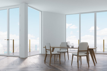 White dining room, white and wooden chairs