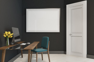 Black home office with a poster