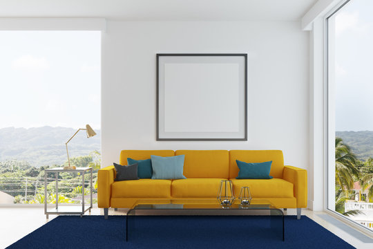 Yellow sofa, blue and green pillows living room