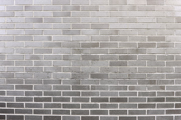 Old grey brick wall background