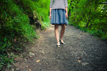 Young woman walking in woods
