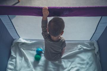 Little baby in playpen