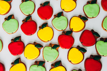 Delicious gingerbread in the form of multi-colored apples. Cooking. Bakery products.