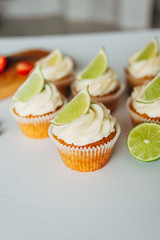 .Cupcakes with cream and lime. Baking.