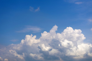 Fluffy cumulus clouds on blue sky