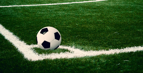 View of soccer ball on athletic field in stadium arena