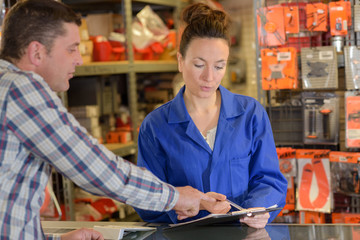 hardwarer store worker with customer