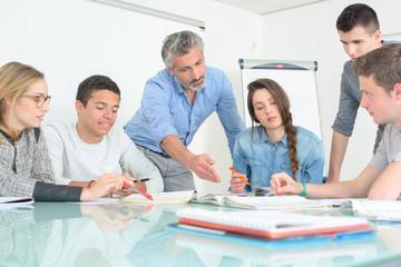 young people teacher discuss communicate university classroom
