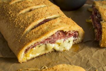 Homemade Cheesy and Meaty Italian Stromboli