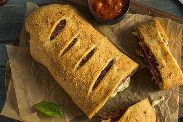Homemade Cheesy and Meaty Italian Stromboli