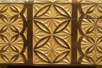 background: woodcarving (fragment of a wooden homemade casket closeup)