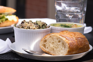 Delicious business lunch served on the outside table. Lunch included healthy quinoa salad,fresh baguette and soup.