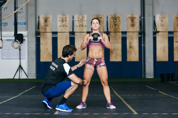 Woman training with coach