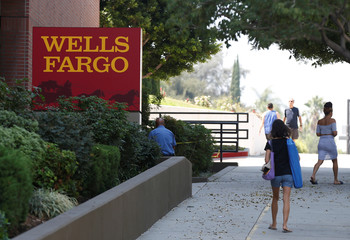People walk by a Wells Fargo banking location in Pasadena