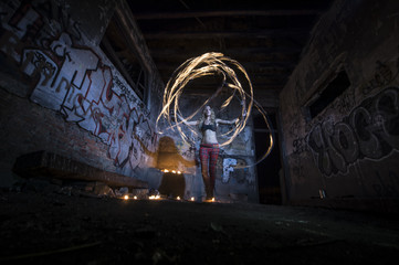 Woman making fire show Wall mural
