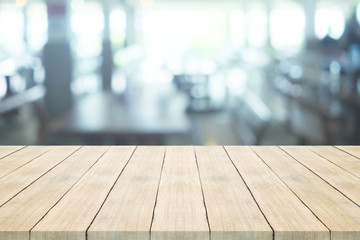 Empty wood table top on blurred background at coffee shop,space for montage products
