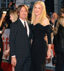 """Actor Nicole Kidman arrives with her husband Keith Urban at the premiere of the film """"The Upside"""" at Toronto International Film Festival."""