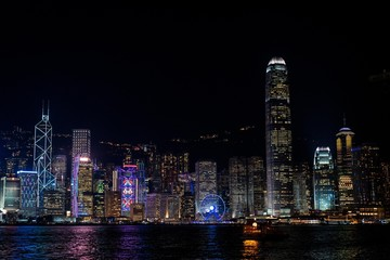 Victoria Harbour, Hong Kong.  Night skyline. Cityscape and city.