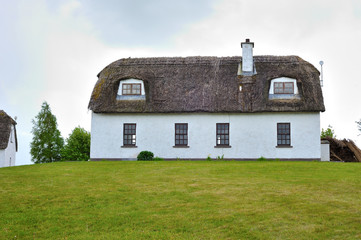 Fully restored old thatched roof cottage used as a hostel, irish medieval and contemporary houses.