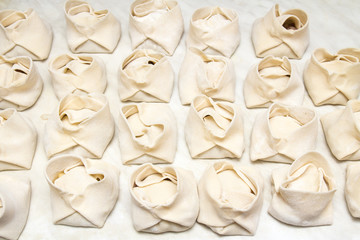 steamed dumplings of dough with meat