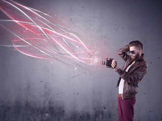 Elegant hipster with camera and bright lines