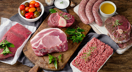 Keuken foto achterwand Vlees Fresh raw meat on dark wooden background.