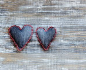 Denim hearts on a wooden background for Valentine's Day, selective focus