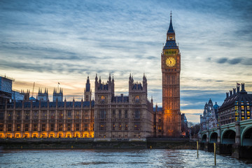 London, England - The famous Big Ben, Houses of Parliament and Westminster Bridge at dusk