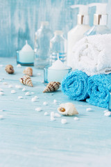 White flowers lying on and candle Spa set