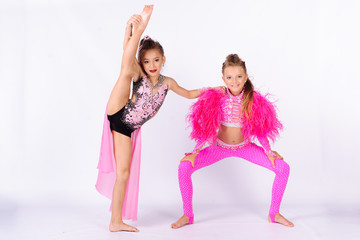 Flexible kids gymnasts, isolated on white background. Sport, active lifestyle concept