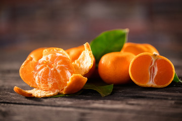 Mandarins. Tangerines close-up on a wooden background.
