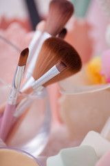 Beauty cosmetic tools and hair accessories in basket.